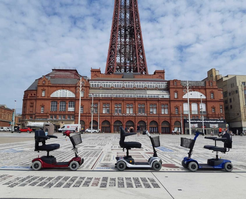 3 Mobility Scooters outside Blackpool Tower Headlands