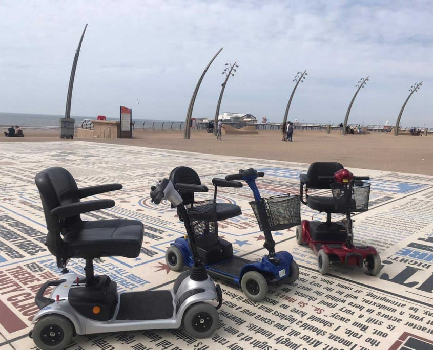 3 mobility scooters on Blackpool Comedy Carpet