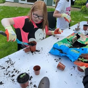 Young Carers potting plants